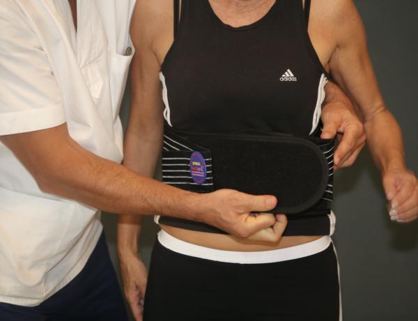 Patient wearing lumbar belt